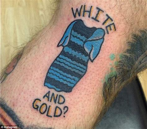 Tattoo Black And Blue Dress | man gets tattoo of roman originals dress on his calf