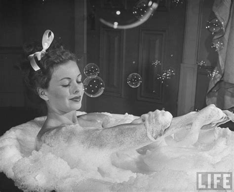 women in the bathroom fashionable forties take a bath for beauty