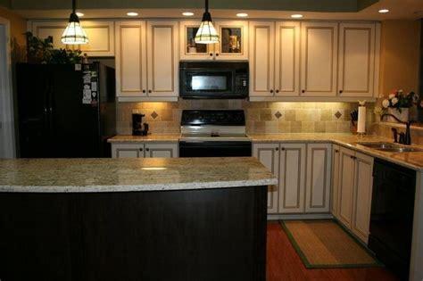 white kitchen cabinets black appliances white cabinets