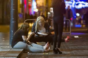 Tea for two two women sit on the kerb on st mary street in cardiff as