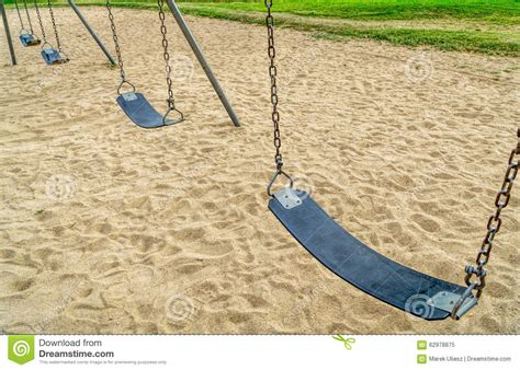 swing row empty swings in playground stock photo image 62978875