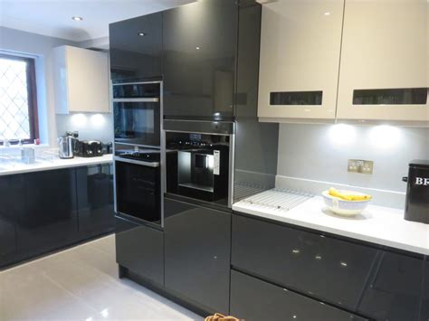 Gloss Anthracite & cashmere handle less kitchen in