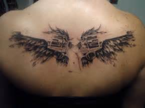 angel wings with guns tattoos foot tattoos design
