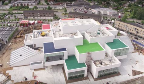 big lego house drone video offers sneak peek at big s lego house set to open next month
