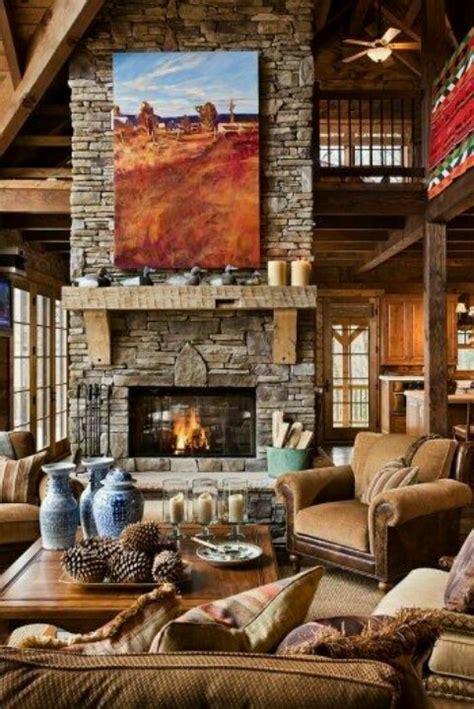 log cabin living room stone fireplace open loft second floor mountain feel