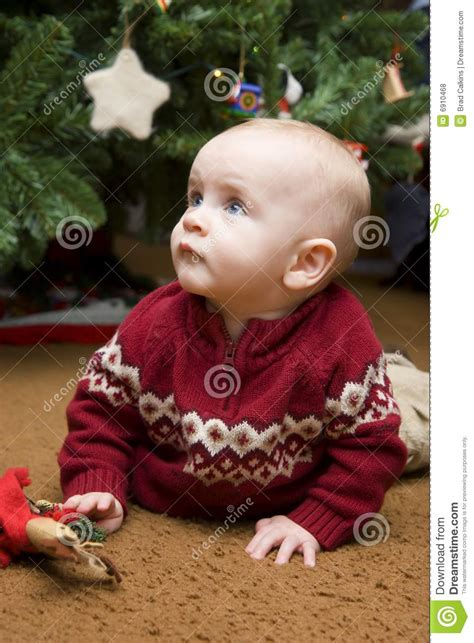 baby under christmas tree stock photo image of gazing