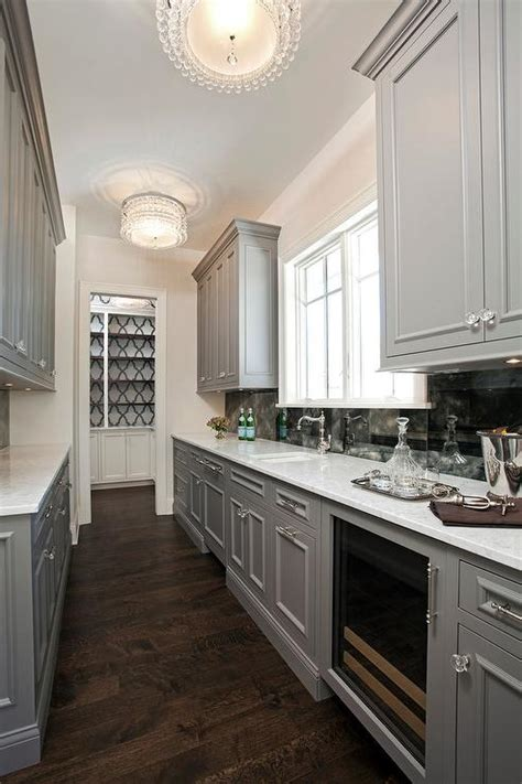 gray galley style butlers pantry  beaded flush mounts