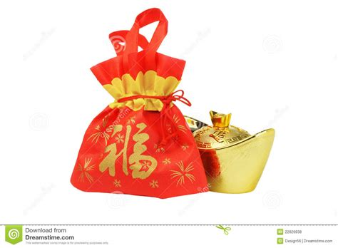 new year gift to in new year gift bag and gold inpgot ornament stock