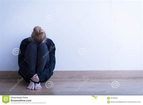 Curled Up On The by Sitting Curled Up Stock Photo Image 59795263