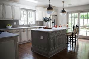 grey kitchen island gray center island with three glass lanterns