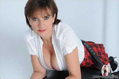 tied to spanking bench lady sonia in short skirt and stockings bound with leather