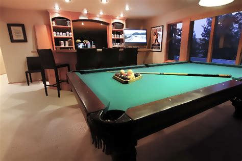 rec room tables spacious recreation room with pool table and bar the