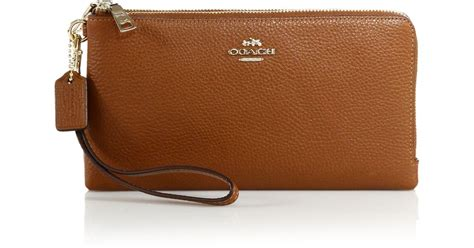 Coach Htons Vintage Leather Wristlet by Coach Pebbled Leather Wristlet In Brown Saddle Lyst
