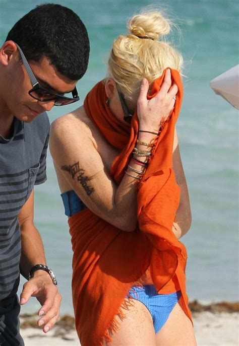 new tattoo got wet lindsay lohan gets really wet in miami the hollywood gossip