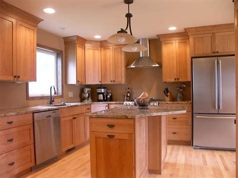 what goes where in kitchen cabinets what color granite goes with natural cherry cabinets