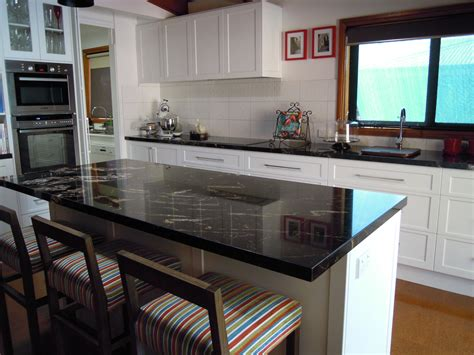 Kitchen features GraniteTitanium Benchtops & Formica Vinyl
