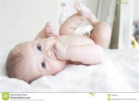 Baby Rolled by Baby Boy Rolling On Bed Royalty Free Stock Image