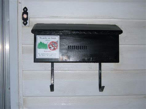 mailbox attached to house letter box