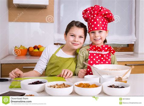 family kitchens kitchens that are friends for kids happy girls cooking together stock photo image 66733934