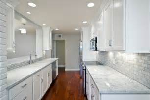 white kitchen cabinets with light countertops