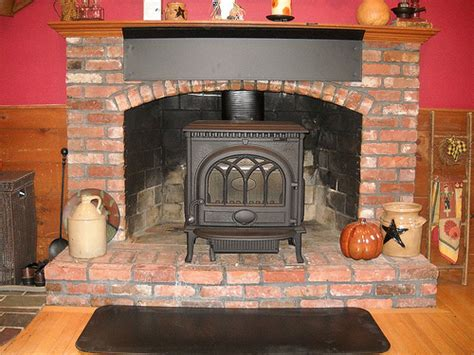 Wood Stove Inside Fireplace by Photo