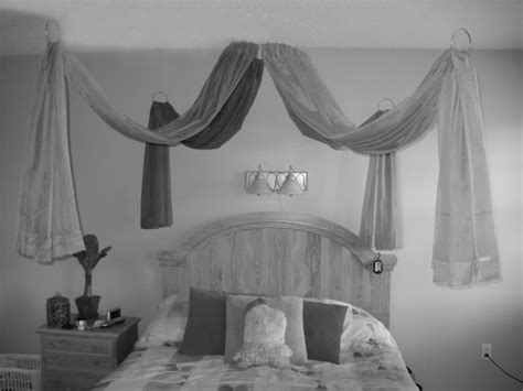Bed With Curtains Hanging From Ceiling - curtain rods hang from the ceiling to simulate a canopy