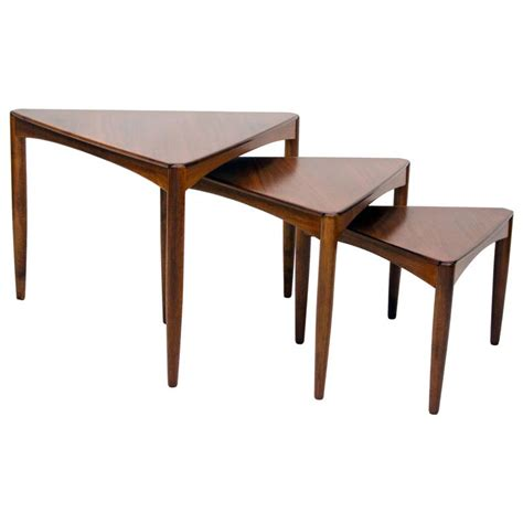 set of three mid century walnut triangular nesting tables