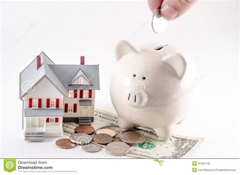 buying a house from the bank saving to build buy a home house piggy bank with coin being stock photo image