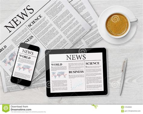 news mobile news page on tablet mobile phone and newspaper royalty