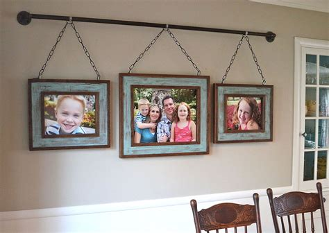 unique ways to hang pictures iron pipe family photo display after building rustic