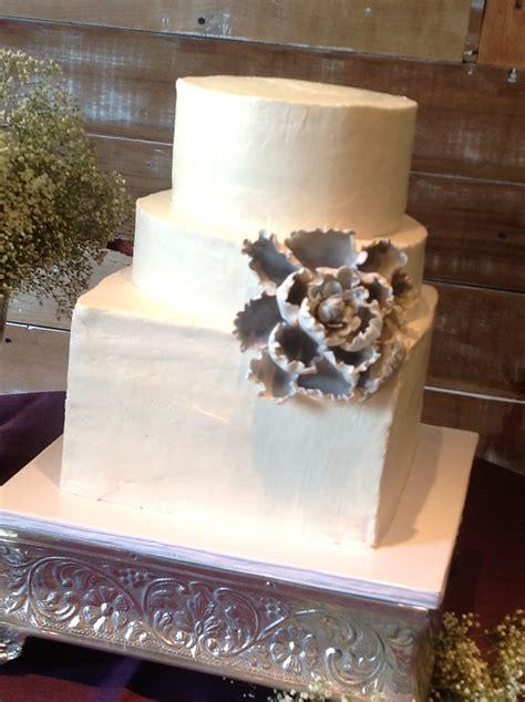 plumeria cake studio rustic buttercream wedding cake  grey flower
