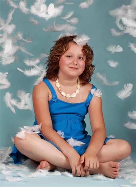 preteen girl with white feathers stock image image of preteen girl with white feathers stock image image of