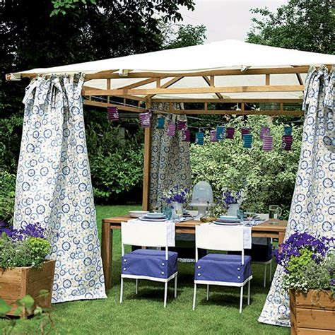 gazebo curtain ideas garden gazebo with blue floral curtains and paper lanterns