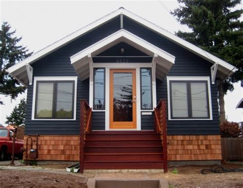 blue house orange door navy paint orange door wood accents soot body