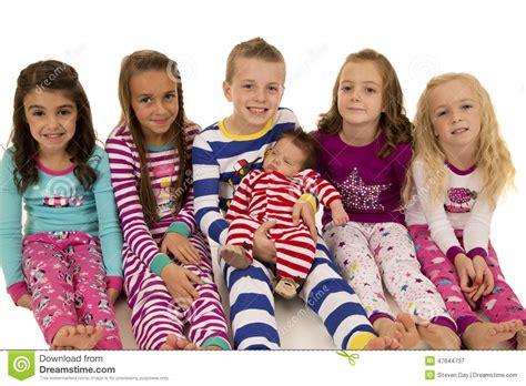 Superior Baby Girl Christmas Pyjamas #7: Six-beautiful-children-wearing-their-winter-pajamas-sitting-47644737.jpg