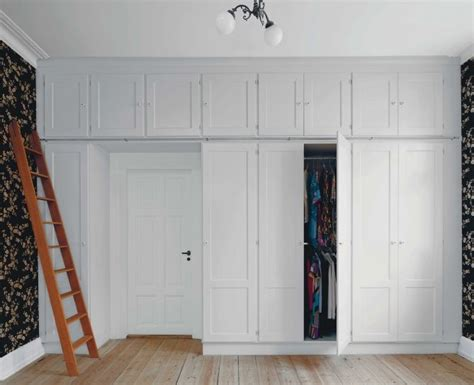 Above Closet Storage built in closet with storage cubbies above cubbies extend