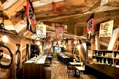 libro izakaya the japanese pub reclaimed wood clads this japanese izakaya s origami like interior in montreal inhabitat