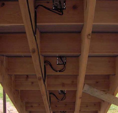 installing lights on deck underside of deck steps showing low voltage deck lighting