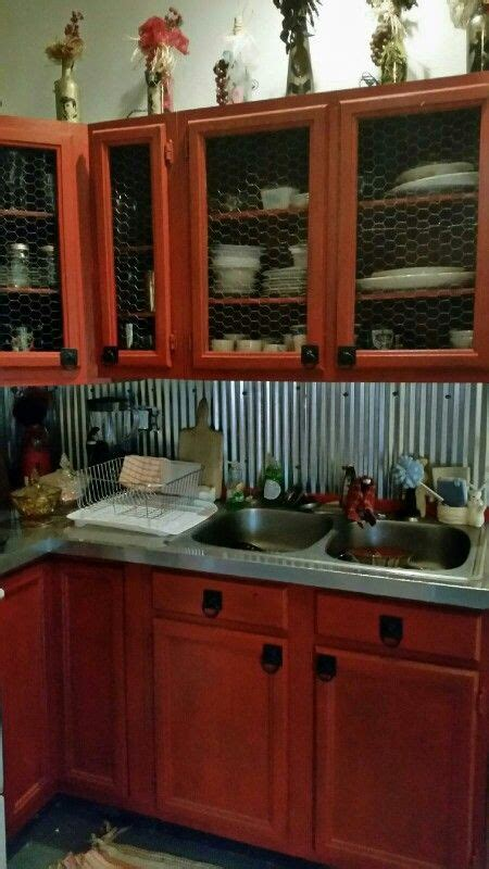 chicken wire kitchen cabinets my rustic log cabin chicken wire cabinets with stainless