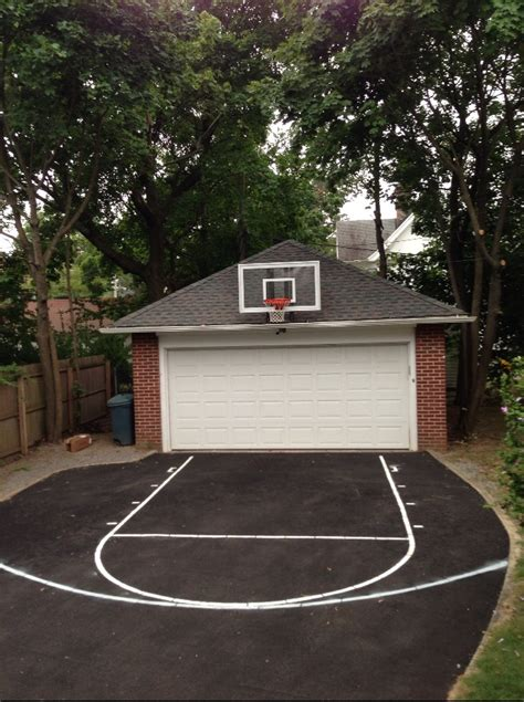 Garage Basketball Goal the roof king platinum sits atop a two car garage and is met with a 17 foot wide asphalt