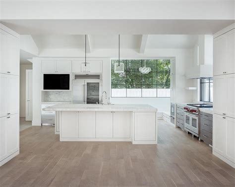 White Modern Kitchen With Gray Wash Wood Floors Modern White Kitchen Cabinets Wood Floors