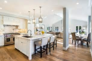 a beautiful open plan kichen with marina oak wood floors