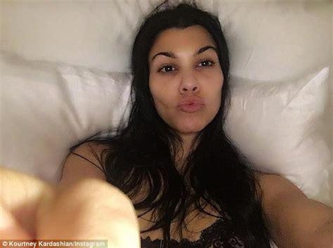 kim kardashian bed kourtney kardashian parties as scott disick insists he s