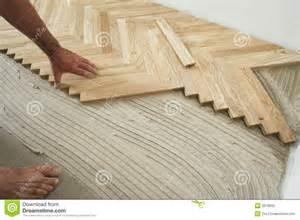 Dark Laminate Floors - parquet floor and carpenter stock photo image 3978800
