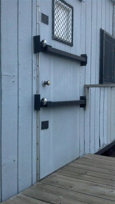 hinged security bar for mobile office trailer doors homes