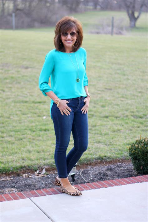 outfits for 40 year olds 27 days of spring fashion green blouse frayed hem jeans