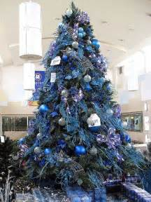 books and blue and silver tree s and