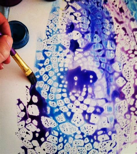 place doily on canvas spray with clear acrylic remove