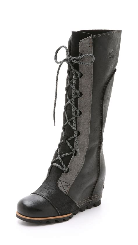 sorel wedge boots lyst sorel cate the great wedge boots black in black