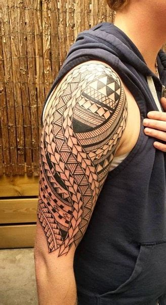 tattoo starter kits edmonton arm decorated with shark teeth and other elements samoan